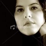 Photograph of reflective woman.