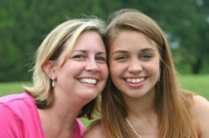 Photo of mother and daughter smiling.