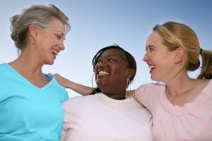 Photo of three women with smiles.